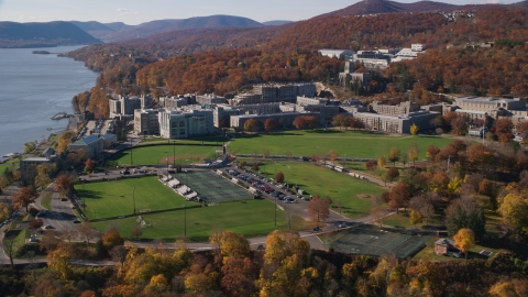 AX119_169.0000095F - Aerial stock photo of Grounds of the United States Military Academy at West Point in Autumn in New York
