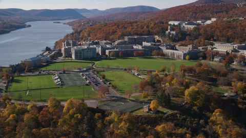 AX119_169.0000201F - Aerial stock photo of Grounds and sports fields at the West Point Military Academy in Autumn, West Point, New York