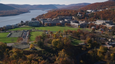 AX119_170.0000109F - Aerial stock photo of Campus of the West Point Military Academy in Autumn, West Point, New York