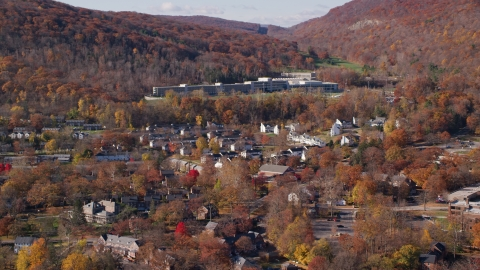 AX119_172.0000034F - Aerial stock photo of Housing at West Point Military Academy in Autumn, West Point, New York