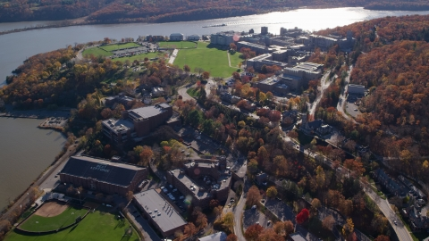 AX119_174.0000073F - Aerial stock photo of The West Point Military Academy by the Hudson River in Autumn, West Point, New York