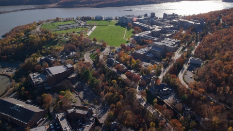 AX119_174.0000216F - Aerial stock photo of The United States Military Academy by the Hudson River in Autumn, West Point, New York