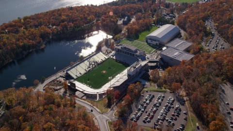 AX119_176.0000060F - Aerial stock photo of Michie Stadium at West Point Military Academy in Autumn, West Point, New York