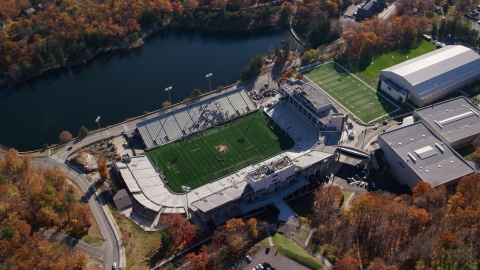 AX119_176.0000205F - Aerial stock photo of Michie Stadium at United States Military Academy in Autumn, West Point, New York