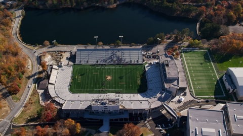 AX119_177.0000102F - Aerial stock photo of Michie Stadium, West Point Military Academy, New York in Autumn