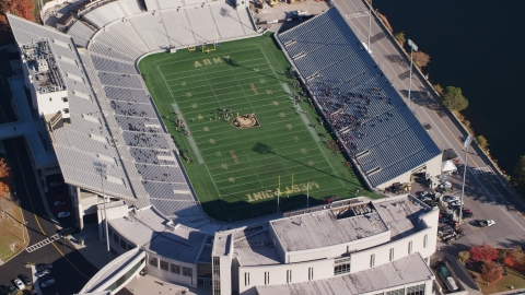 AX119_178.0000078F - Aerial stock photo of Michie Stadium in Autumn, West Point Military Academy, New York