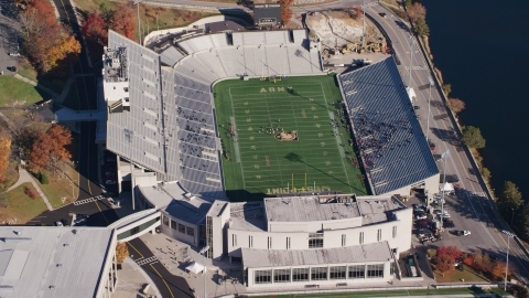 AX119_178.0000177F - Aerial stock photo of Michie Stadium in Autumn at United States Military Academy at West Point, New York