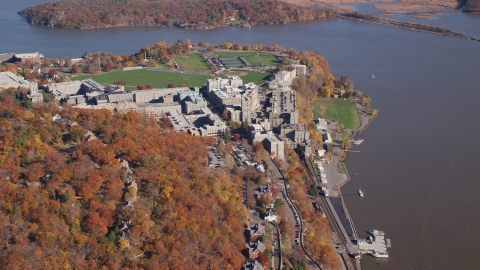 AX119_179.0000186F - Aerial stock photo of West Point Military Academy campus in Autumn, West Point, New York