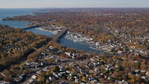 AX119_232.0000028F - Aerial stock photo of Marinas on the Mianus River by homes in Autumn, Greenwich, Connecticut