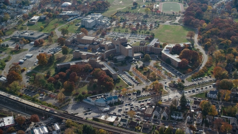 AX120_045.0000099F - Aerial stock photo of Hospital complex in Jamaica, Queens, New York City, in Autumn