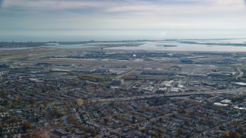 AX120_048.0000243F - Aerial stock photo of John F. Kennedy International Airport in Autumn, Queens, New York City
