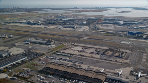 AX120_051.0000055F - Aerial stock photo of JKF International Airport in Autumn, Queens, New York City