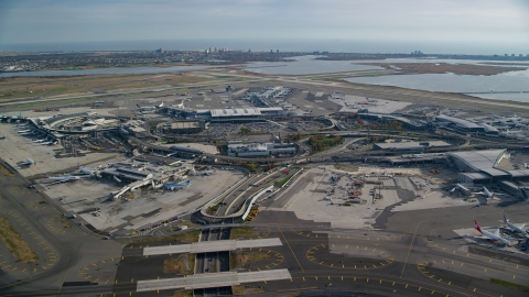 AX120_052.0000103F - Aerial stock photo of John F. Kennedy International Airport, New York City, in autumn