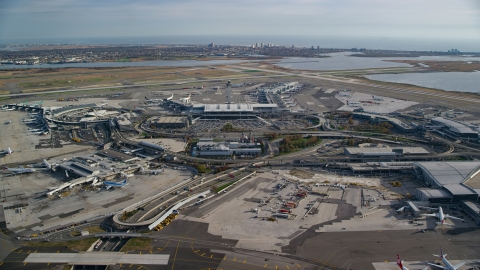 AX120_052.0000262F - Aerial stock photo of JFK International Airport in Autumn, New York City