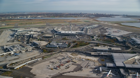 AX120_053.0000124F - Aerial stock photo of Control tower and terminals at JFK International Airport in Autumn, New York City