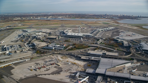 AX120_053.0000303F - Aerial stock photo of John F. Kennedy International Airport in Autumn