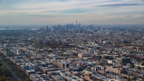 AX120_080.0000094F - Aerial stock photo of Lower Manhattan skyline seen from Brooklyn in Autumn, New York City