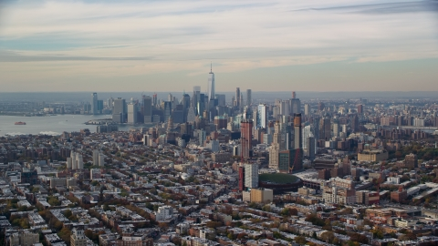 AX120_084.0000126F - Aerial stock photo of Downtown Brooklyn and the Lower Manhattan skyline in Autumn, New York City