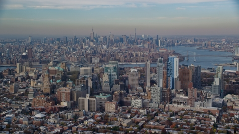 AX120_088.0000069F - Aerial stock photo of Downtown Brooklyn in autumn with Midtown in the background, New York City