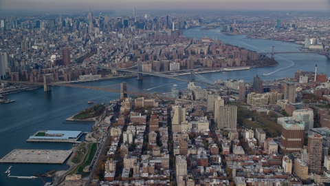 AX120_091.0000087F - Aerial stock photo of The Brooklyn and Manhattan Bridges spanning the East River in Autumn, New York City