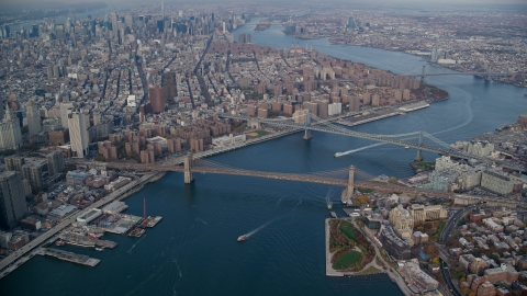 AX120_094.0000060F - Aerial stock photo of Brooklyn and Manhattan Bridges in Autumn, New York City