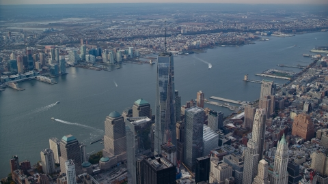 AX120_098.0000086F - Aerial stock photo of Freedom Tower and the Hudson River in Lower Manhattan, New York City