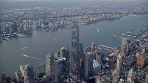 AX120_098.0000203F - Aerial stock photo of One World Trade Center and the Hudson River in Lower Manhattan, New York City