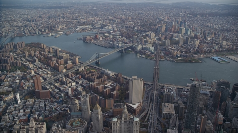 AX120_112.0000056F - Aerial stock photo of Brooklyn Bridge and Manhattan Bridge in New York City
