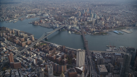 AX120_113.0000091F - Aerial stock photo of Brooklyn Bridge and Manhattan Bridge spanning the East River in New York City