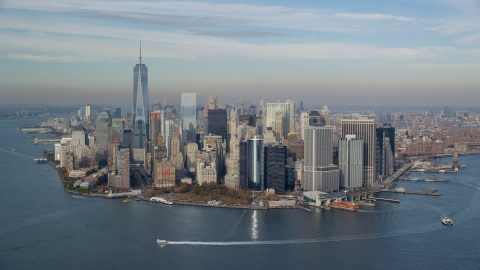 AX120_121.0000290F - Aerial stock photo of Battery Park and Lower Manhattan in Autumn, New York City