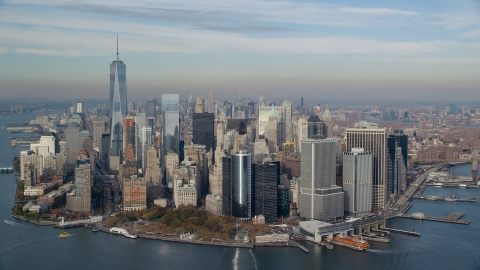 AX120_122.0000245F - Aerial stock photo of Lower Manhattan and Battery Park in Autumn, New York City