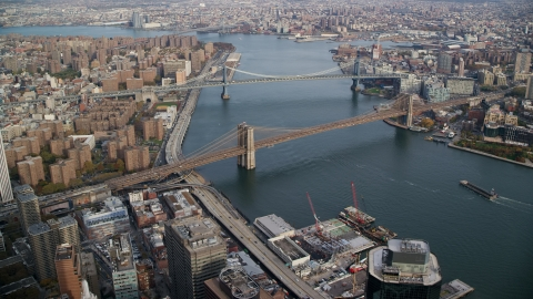 AX120_128.0000000F - Aerial stock photo of The Manhattan Bridge and the Brooklyn Bridge in New York City