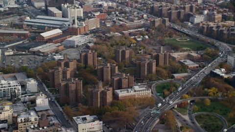 AX120_131.0000093F - Aerial stock photo of Public housing apartment buildings in Autumn, Brooklyn, New York City
