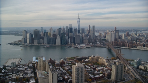 AX120_133.0000243F - Aerial stock photo of Lower Manhattan skyline across the East River, New York City