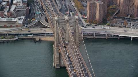 AX120_136.0000144F - Aerial stock photo of Heavy Traffic on the Brooklyn Bridge, New York City