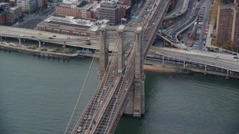 AX120_136.0000273F - Aerial stock photo of Light traffic on the Brooklyn Bridge, New York City