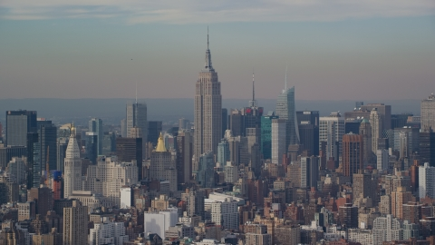 AX120_139.0000076F - Aerial stock photo of The Empire State Building in Midtown Manhattan, New York City