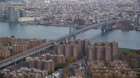 AX120_151.0000123F - Aerial stock photo of The Williamsburg Bridge and public housing in Autumn, New York City