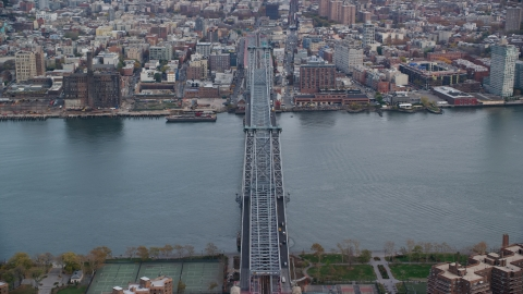 AX120_153.0000145F - Aerial stock photo of Orbit the Williamsburg Bridge in Autumn, New York City
