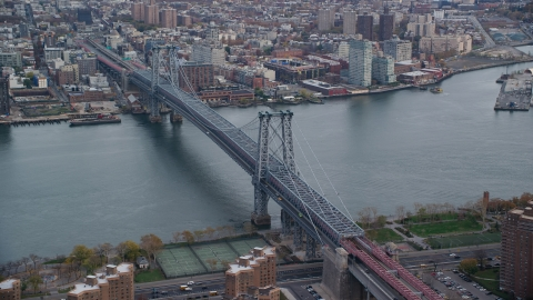 AX120_153.0000347F - Aerial stock photo of The Williamsburg Bridge spanning the East River in Autumn, New York City