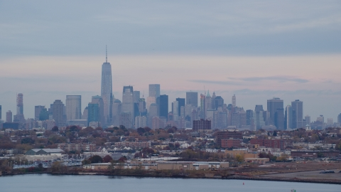 AX121_003.0000059F - Aerial stock photo of The Lower Manhattan skyline at sunset in Autumn, New York City