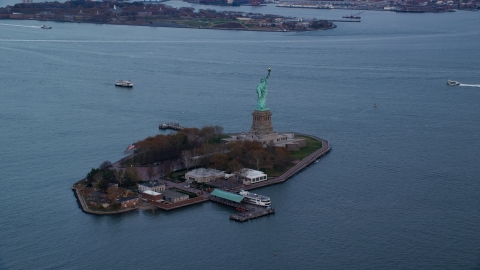 AX121_013.0000082F - Aerial stock photo of The Statue of Liberty at sunset In Autumn, New York
