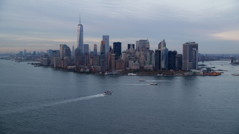 AX121_017.0000111F - Aerial stock photo of Battery Park and the Lower Manhattan skyline at Sunset, New York City