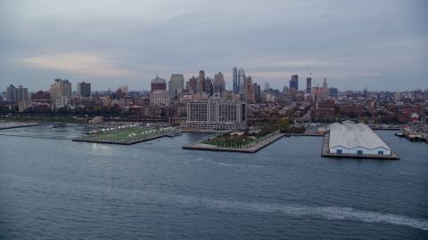AX121_020.0000174F - Aerial stock photo of Piers 5 and 6 and Brooklyn skyline at sunset in New York City