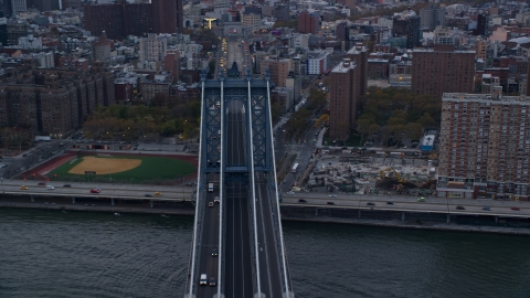 AX121_025.0000168F - Aerial stock photo of Manhattan Bridge at sunset in New York City