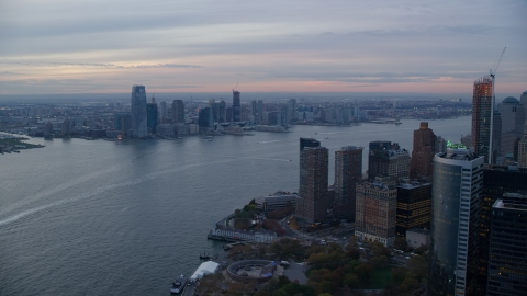 AX121_035.0000051F - Aerial stock photo of Downtown Jersey City at sunset seen from Lower Manhattan, New York City