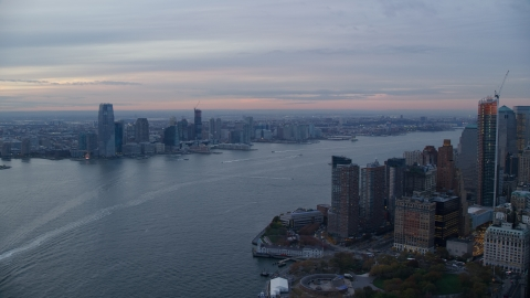 AX121_035.0000185F - Aerial stock photo of Downtown Jersey City, New Jersey at sunset seen across the Hudson River