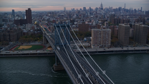 AX121_041.0000041F - Aerial stock photo of The Manhattan Bridge at sunset in New York City