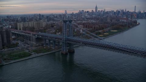 AX121_045.0000046F - Aerial stock photo of The Williamsburg Bridge at sunset in New York City