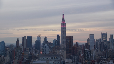 AX121_050.0000054F - Aerial stock photo of The Empire State Building at sunset in New York City